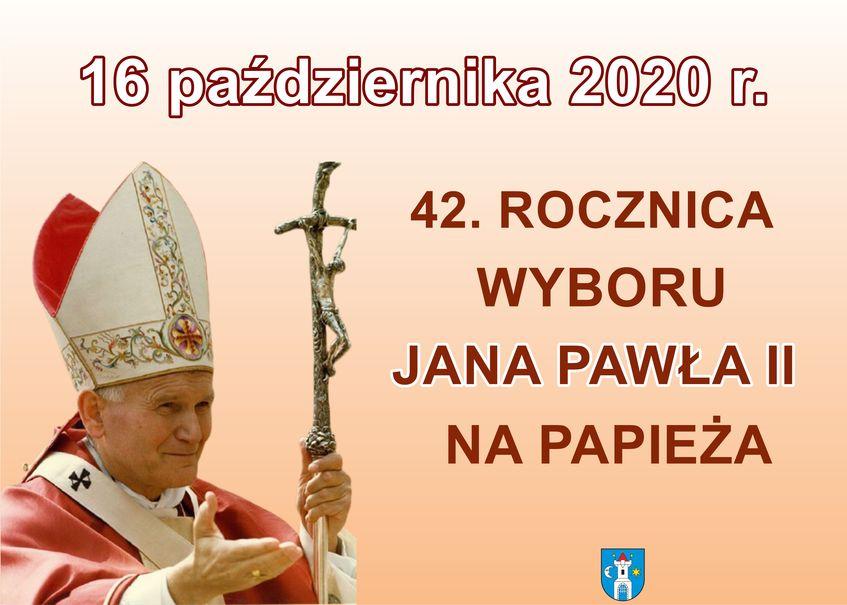 Prostokątny plakat z czerwonymi napisami. Po lewej stronie widać Świętego Jana Pawła II. Na dole na środku znajduje się herb Świebodzic.