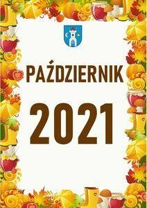 Pionowy prostokąt o złoto - brązowych barwach i białym środku z brązowym napisem Październik 2021 i herbem miasta.