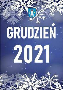Pionowy prostokąt z białym napisem Grudzień 2021. Na górze i dole białe śnieżynki.